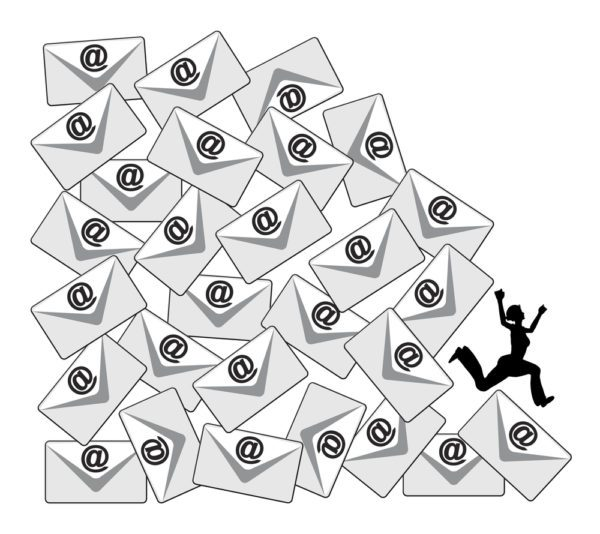 A woman runs from a mountain made of envelopes symbolizing an overload of email