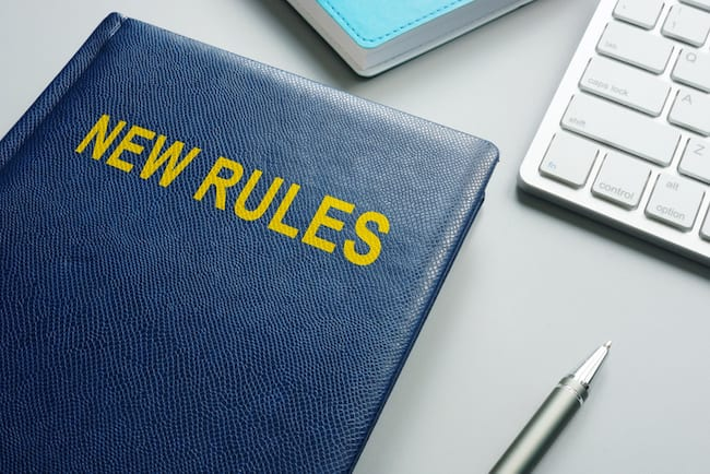 Book with title New rules and regulations in an office.