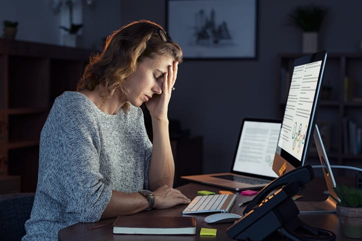 business woman in need of burnout recovery plan